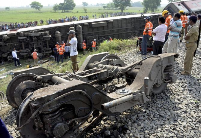 Authorities look on after the Rajdhani Express derailed in Chhapra