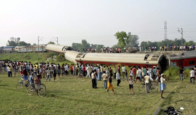 Locals crowd around the site of the derailment.