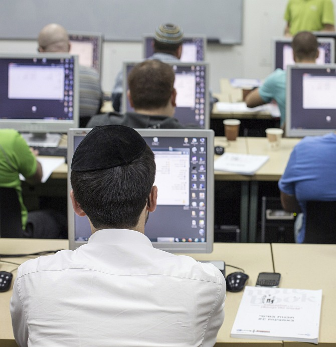 An ultra-orthodox Jewish man attends a computer course at a technical college in Jerusalem