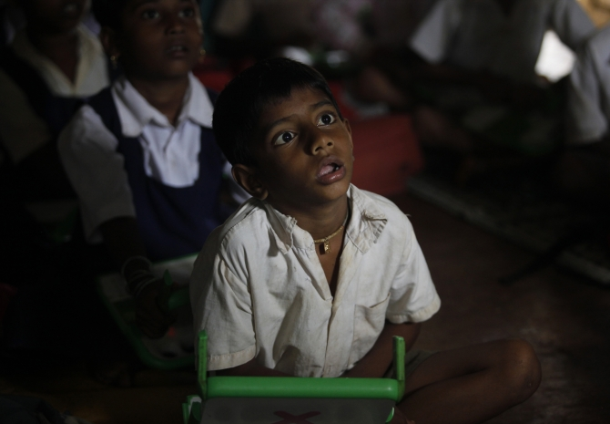 A school boy uses a laptop provided under the One Laptop Per Child' project by a non-governmental organisation, in a state-run primary school, on the eve of International Literacy Day at Khairat village, about 90 km from Mumbai.