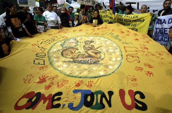 Activists from various non-governmental organisations participate in an environment awareness march in New Delhi.