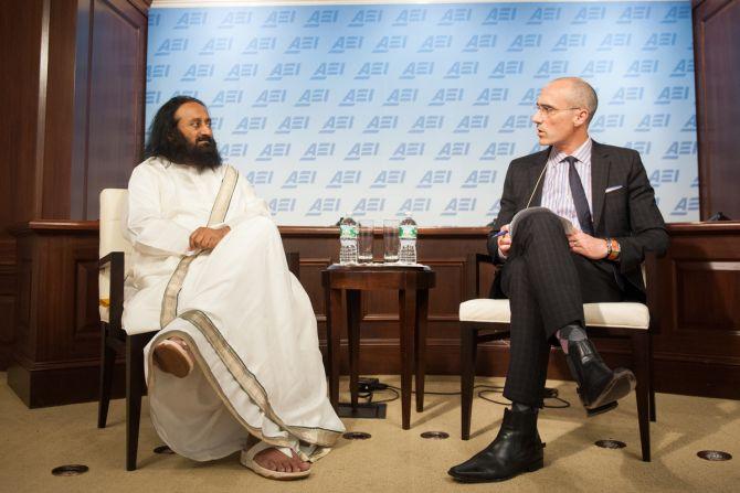 Spiritual guru Sri Sri Ravi Shankar with American Enterprise Institute president Arthur Brooks
