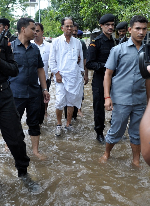 Assam Chief Minister Tarun Gogoi visits flood affected area of MLA Hostel at the Assam secretariat, Dispur in Guwahati after a heavy downpour in Thursday night.