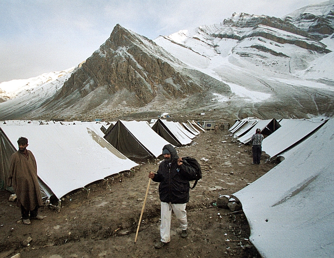 - A pilgrim walks during an annual pilgrimage to the Amarnath cave of Lord Shiva