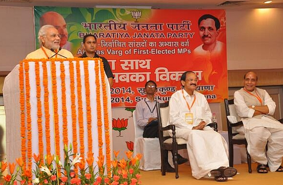 Modi addresses first time MPs at an orientation camp in Surajkund as Union ministers M Venkaiah Naidu and Rajnath Singh look on