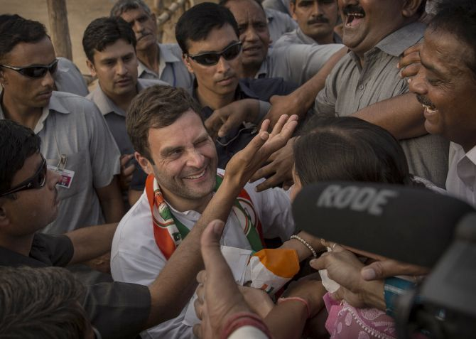Rahul Gandhi, leader of India's ruling Congress Party is embraced by a supporter at a rally in New Delhi.