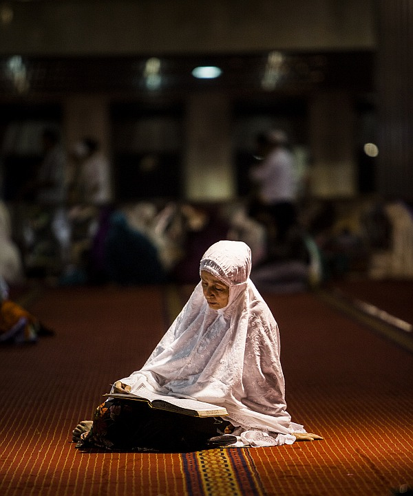 An Indonesian Muslim reads the Quran during prayers known as Tarawih at Istiqlal Mosque, the largest mosque in Southeast Asia.