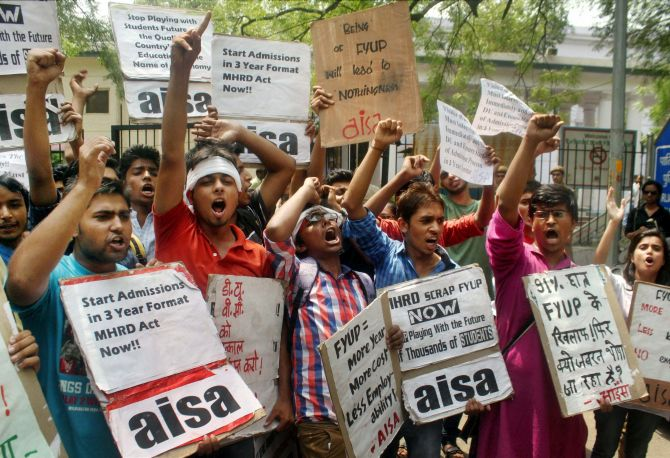Delhi University students protest demanding scrapping of the four-year course