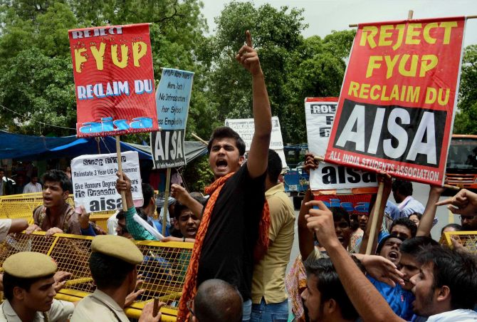 Students shout slogans in a protest against the FYUP programme