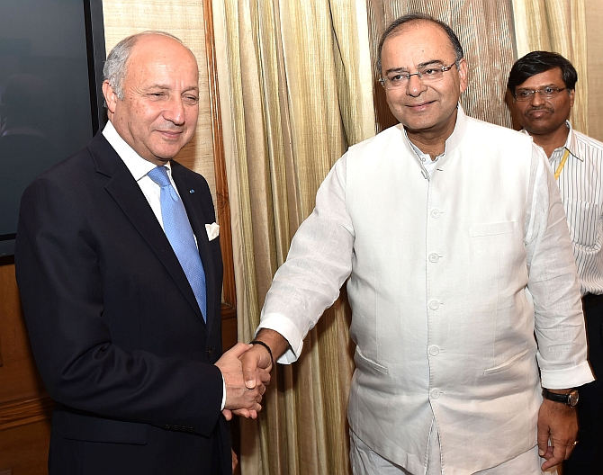 France Foreign Minister Laurent Fabius meets Union Minister for Finance, Corporate Affairs and Defence Arun Jaitley in New Delhi