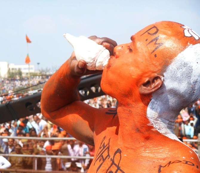 A BJP supporter attends Modi's rally in Lucknow