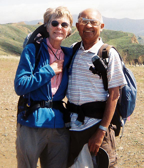 Joy and Dinesh Desai, during a 20+ mile hike on the Pacific coast of California, near San Francisco.