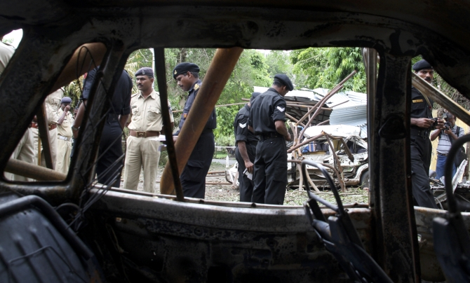 NSG commandos search for evidence at a bomb blast site in Ahmedabad after the July 2008 blasts