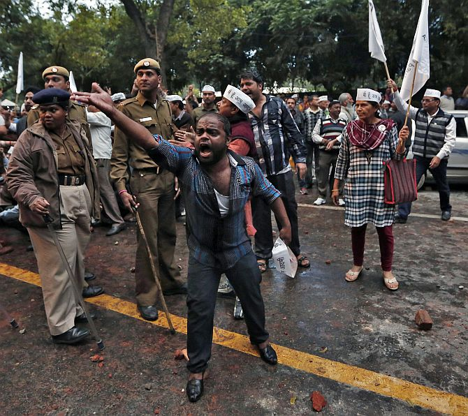 An AAP supporter shouts slogans outside the BJP headquarters