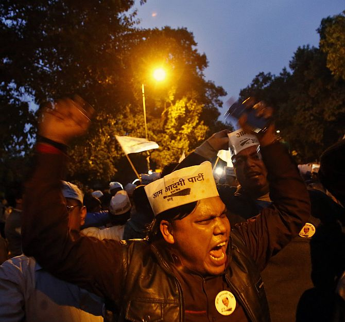 AAP supporters shout slogans during the protest outside the BJP headquarters