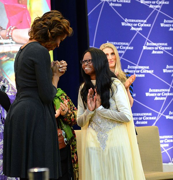 US First Lady Michelle Obama honors 2014 International Women of Courage Awardee Laxmi, a Campaigner for Stop Acid Attacks in India, at the 2014 Secretary of State's International Women of Courage Award Ceremony