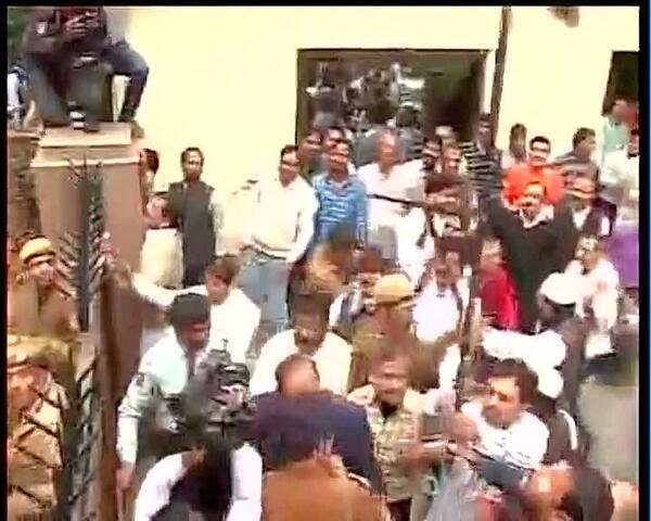 AAP workers protest outside the BJP's office in Delhi