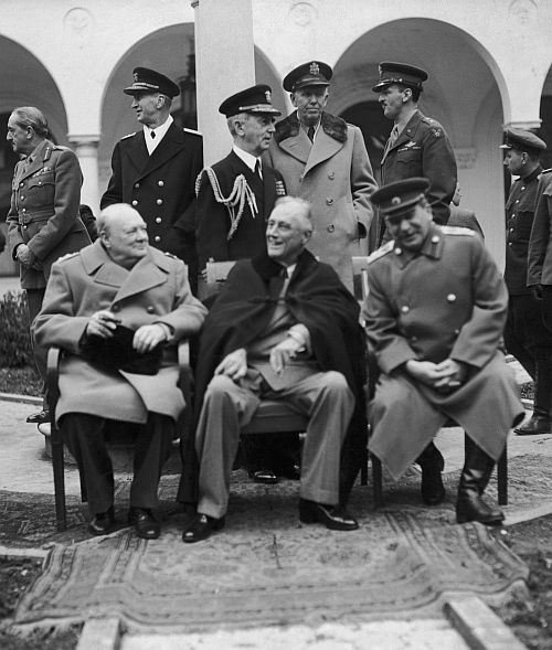 Left to right: British Prime Minister Winston Churchill, US President Franklin Delano Roosevelt and Soviet leader Josef Stalin at the Livadia Palace, Yalta, February 8, 1945. Below: The courtyard of the Livadia Palace.