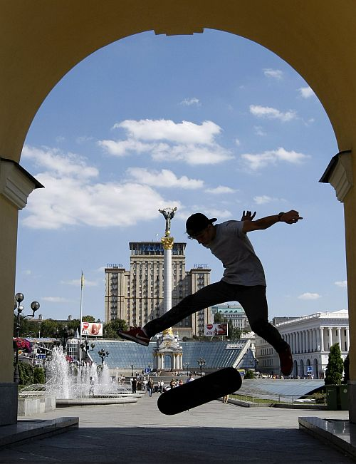 A boy skateboards in the central Kiev city square.