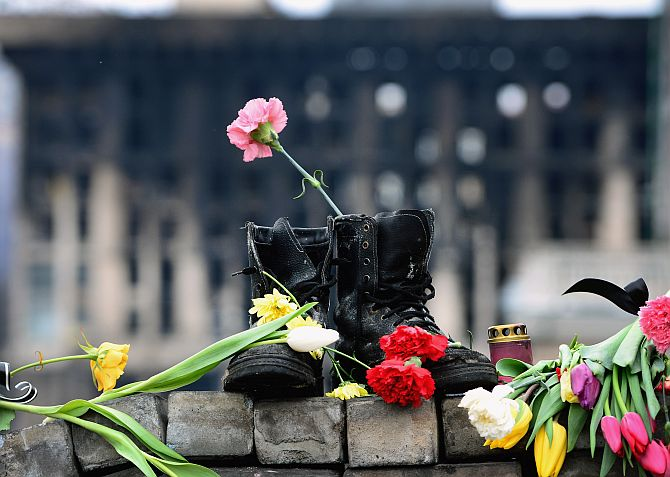 A pair of boots placed as a memorial to an anti-Yanakovych protestor killed in clashes with riot police in Kiev.