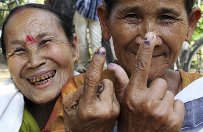 Voters after casting their vote in Khorkhari village, Assam.
