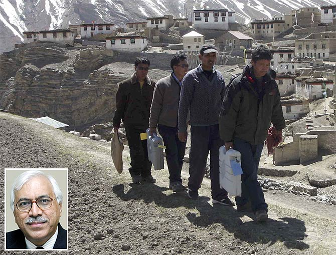 Polling officers carry Electronic Voting Machines to a polling station in Himachal Pradesh; Inset, Former CEC S Y Quraishi.