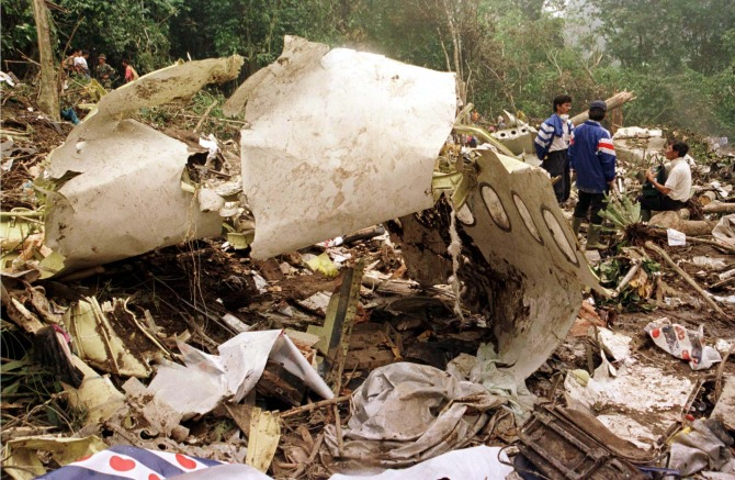 Rescue workers near the torn fuselage of the Garuda Airlines Airbus A300 which crashed into heavy jungle near Medan in Sumatra.