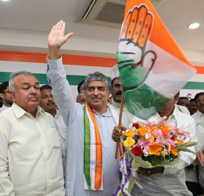 Nilekani waves to his supporters as he is officially inducted in Congress on Sunday