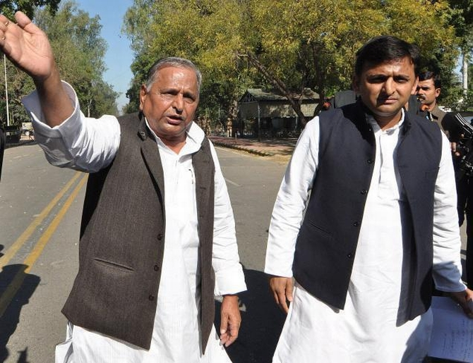 Samajwadi Party chief Mulayam Singh Yadav with son and UP CM Akhilesh