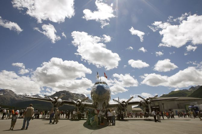 People stand around a vintage Lockheed L-1049 Super Constellation aircraft during the Engiadina Classics airshow at the airport in the town of Samedan, near the eastern Swiss mountain resort of Sankt Moritz