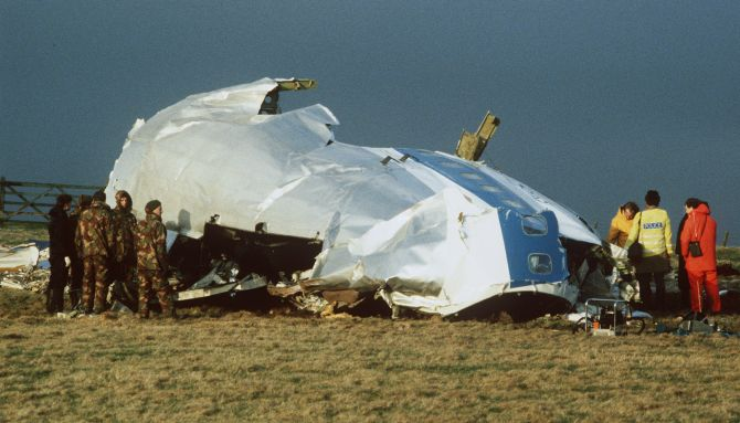 Scottish rescue workers and crash investigators search the area around the cockpit of Pan Am flight 103 in a farmer's field east of Lockerbie Scotland after a mid-air bombing killed all 259 passengers and crew, and 11 people on the ground
