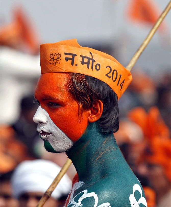 A BJP supporter at a rally being addressed by Narendra Modi in Meerut, UP.