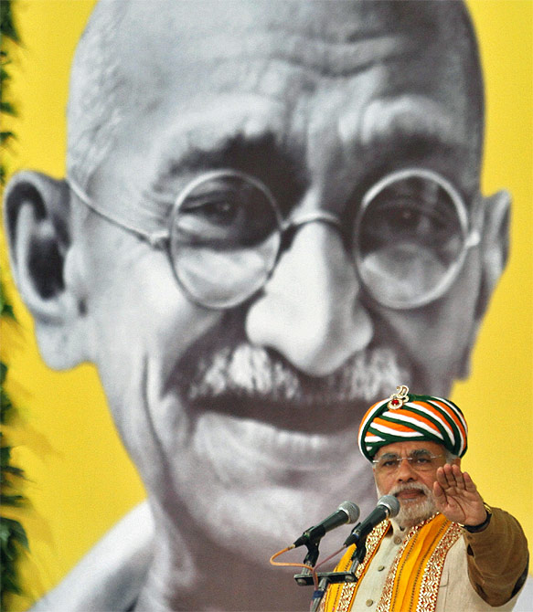 Narendra Modi, then Gujarat's chief minister, against a backdrop of the Mahatma