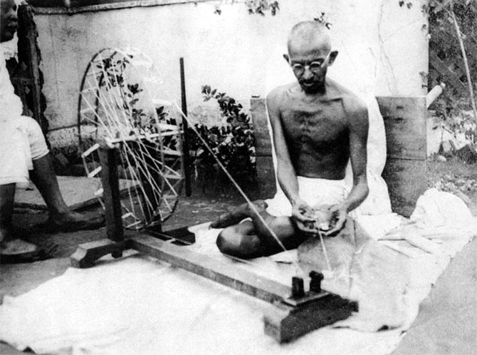 Mahatma Gandhi with his spinning wheel.