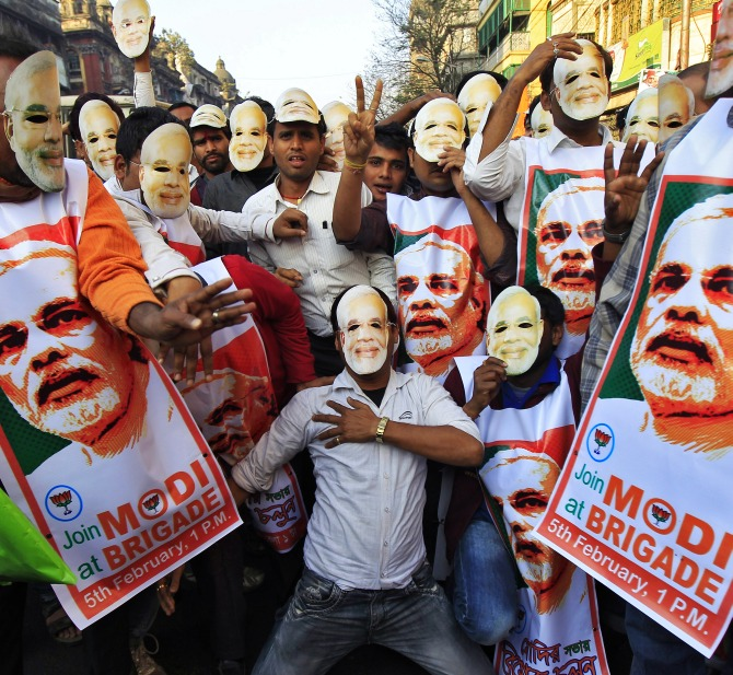 Supporters of the Bharatiya Janata Party's prime ministerial candidate Narendra Modi, as they attend a party campaign rally in Kolkata.