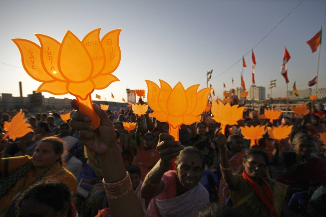Modi supporters hold BJP symbols during a rally being addressed by Modi in Chennai.
