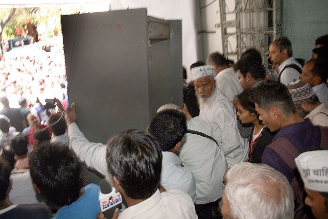 A metal detector at Churchgate station is stormed by AAP leader Arvind Kejriwal's supporters