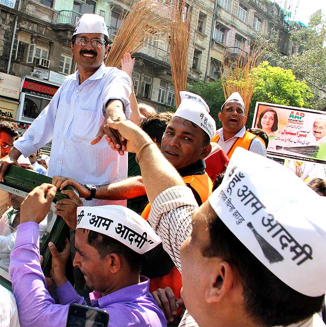 AAP leader Arvind Kejriwal greets a supporter in Mumbai on Wednesday, March 12.