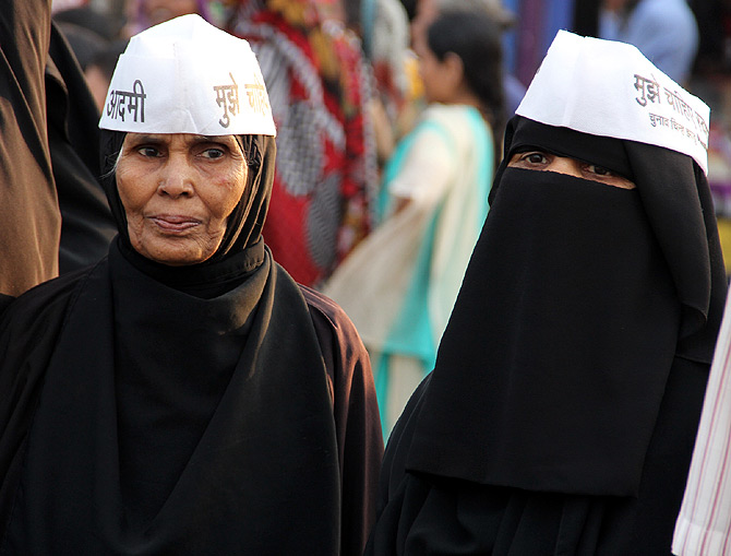 Kejriwal supporters join his road show in Mumbai.