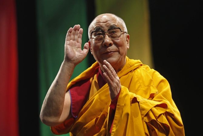 The Dalai Lama greets the audience before his conference: A guide to the way of life of Bodhisattva, in Mexico City.