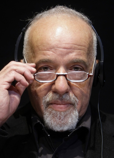 Brazilian author Paulo Coelho pauses during the opening news conference of the Frankfurt book fair.