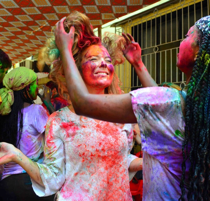 Tourists enjoy the spirit of Holi in Mumbai