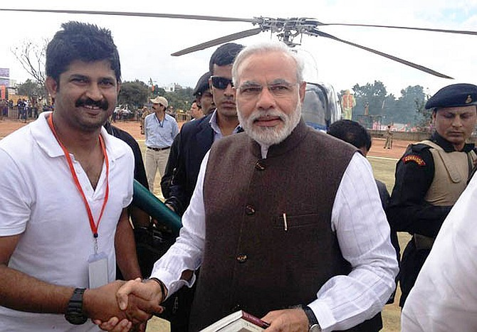 Columnist-turned-politician Prathap Simha with Modi