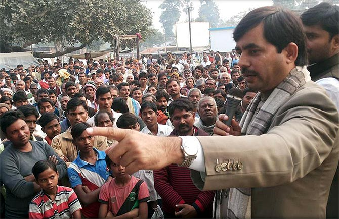 BJP spokesperson Shahnawaz Hussain interacts with party supporters