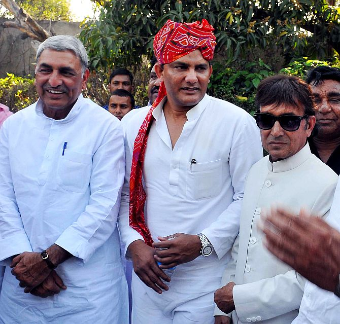 Azharuddin, donning a traditional Rajasthani pagdi, speaks to Congress leaders during a function in Jaipur
