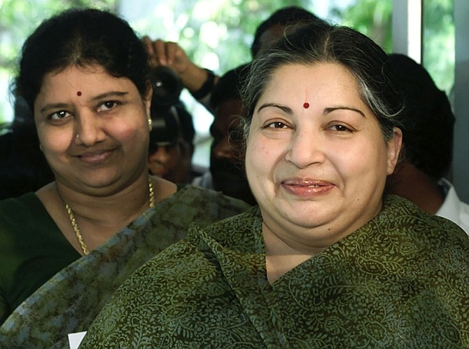 Jayalalitha with Sasikala Natarajan and an unidentified woman at a polling booth in Chennai in this May 10, 2001 picture