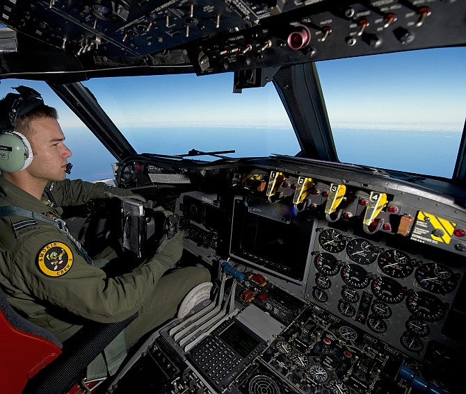 Royal Australian Air Force pilot, Flight Lieutenant Russell Adams from 10 Squadron, steers his AP-3C Orion over the Southern Indian Ocean during the search for missing Malaysian Airlines flight MH370