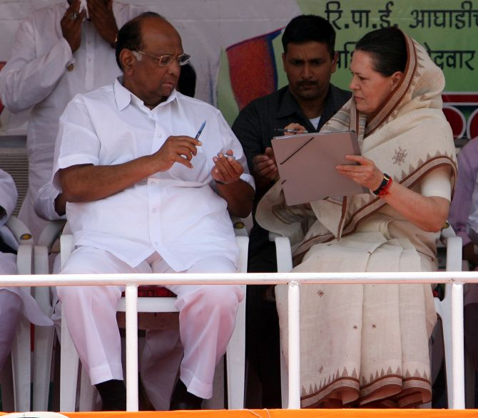 NCP chief Sharad Pawar speaks with Congress president Sonia Gandhi during a rally in Nagpur