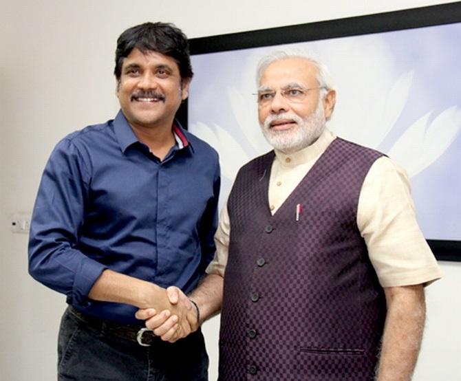 Nagarjuna shakes hands with Modi in Ahmedabad