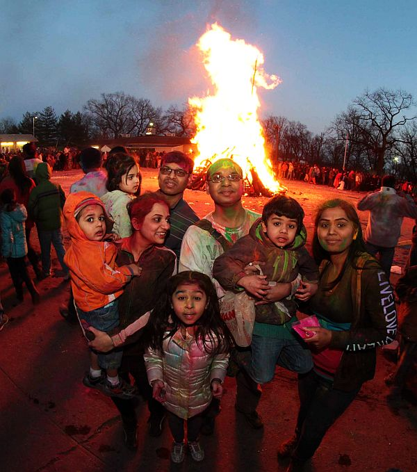 Devotees gather around Holika Dahan during Holi festivities at New Jersey's Dwarkadhish Temple
